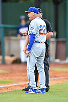 Kingsport Mets manager Rich Donnelly (22) discusses a call with home plate umpire Zachary Robbins during a game against the Elizabethton Twins at Joe O'Brien Field on July 6, 2019 in Elizabethton, Tennessee. The Twins defeated the Mets 5-3. (Tony Farlow/Four Seam Images)