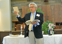 NWA Democrat-Gazette/MICHAEL WOODS &bull; @NWAMICHAELW<br /> Daniel Levine, a member of Temple Shalom of Northwest Arkansas, holds up a piece of matzah as he leads the community Passover Seder on Saturday, April 23, 2016, in Fayetteville.  During Passover Jews eat unleavened bread to symbolize the haste with which they had to leave Egypt.