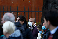 Faithful wearing masks to protect themselves from the Covid-19 arrive to attend the penitential procession on Ash Wednesday, led from the Pope to open Lent in Rome, February 26, 2020. Faithful wearing masks to protect themselves from the Covid-19 arrive to attend the penitential procession on Ash Wednesday, led from the Pope to open Lent in Rome, February 26, 2020.<br />