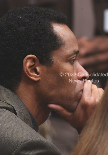 Sniper suspect John Allen Muhammad stares straight ahead after being found guilty on four charges in courtroom 10 at the Virginia Beach Circuit Court in Virginia Beach, Virginia on November 17, 2003.<br /> Credit: Dave Ellis - Pool via CNP