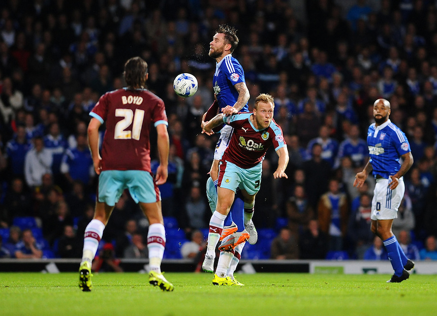Burnley's Scott Arfield challenges Ipswich Town's Daryl Murphy in the air for the ball<br /> <br /> Photographer Ashley Pickering/CameraSport<br /> <br /> Football - The Football League Sky Bet Championship - Ipswich Town v Burnley - Tuesday 18th August 2015 - Portman Road - Ipswich<br /> <br /> &copy; CameraSport - 43 Linden Ave. Countesthorpe. Leicester. England. LE8 5PG - Tel: +44 (0) 116 277 4147 - admin@camerasport.com - www.camerasport.com