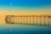 Pier on Lake Winnipeg with rising moon<br /> Matlock<br /> Manitoba<br /> Canada