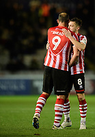 Lincoln City's Lee Frecklington, right, embraces team-mate Matt Rhead as the latter is substituted in the second half<br /> <br /> Photographer Chris Vaughan/CameraSport<br /> <br /> The Emirates FA Cup Second Round - Lincoln City v Carlisle United - Saturday 1st December 2018 - Sincil Bank - Lincoln<br />  <br /> World Copyright © 2018 CameraSport. All rights reserved. 43 Linden Ave. Countesthorpe. Leicester. England. LE8 5PG - Tel: +44 (0) 116 277 4147 - admin@camerasport.com - www.camerasport.com