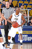 25 February 2012:  FIU guard Deric Hill (1) handles the ball in the second half as the FIU Golden Panthers defeated the University of South Alabama Jaguars, 81-74, at the U.S. Century Bank Arena in Miami, Florida.