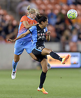 Christen Press (23) of the Chicago Red Stars clears the ball in front of Ellie Brush (8) of the Houston Dash in the first half on Saturday, April 16, 2016 at BBVA Compass Stadium in Houston Texas.