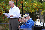 Bud Southard, president of the Navy League, reads a proclamation from Gov. Brian Sandoval during a ceremony at the U.S.S. Nevada Memorial on the Capitol grounds in Carson City, Nev., on Wednesday, Oct. 14, 2015. Veteran Charles Sehe, center, who served on the U.S.S. Nevada during World War II was honored. (Cathleen Allison/Las Vegas Review-Journal)