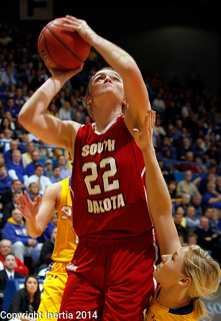 SIOUX FALLS, SD - MARCH 10:  Bridget Arens #22 from University of South Dakota shoots past Mariah Clarin #40 from South Dakota State University in the second half of their semifinal game Monday afternoon at the 2014 Summit League Basketball Tournament in Sioux Falls, SD. (Photo by Dave Eggen/Inertia)