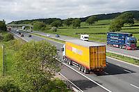 M6 motorway going through farmland near Garstang, Lancashire.