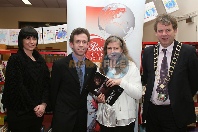 Elaine Grennan, Beverage Business Solutions, Colin Bell and Mayor Michael O'Dowd present Ann Keavney with a copy of the Catalogue at the Launch of the Drogheda Photographic Club's Annual Exhibition in Drogheda Library, Stockwell Street...Photo NEWSFILE/Jenny Matthews.(Photo credit should read Jenny Matthews/NEWSFILE)....This Picture has been sent you under the condtions enclosed by:.Newsfile Ltd..The Studio,.Millmount Abbey,.Drogheda,.Co Meath..Ireland..Tel: +353(0)41-9871240.Fax: +353(0)41-9871260.GSM: +353(0)86-2500958.email: pictures@newsfile.ie.www.newsfile.ie.FTP: 193.120.102.198.