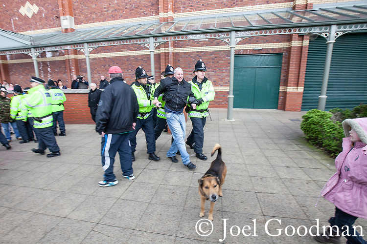 © Joel Goodman - 07973 332324 . 03/03/2012 . Heywood , UK . Police detain a man after the National Front hold a rally in protest against an alleged paedophile ring that had been operating in the area . There is currently (3rd March 2012) a case being tried at Liverpool Crown Court in relation to the allegations . Last Thursday (23rd February 2012) a protest organised in the town in relation to the same story resulted in Asian business being attacked by an angry mob . Photo credit : Joel Goodman