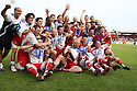Stevenage Borough team celebrate with the Championship trophy after the Blue Square Premier match between Stevenage Borough and York City at the Lamex Stadium, Broadhall Way, Stevenage on Saturday 24th April, 2010..© Kevin Coleman 2010 ..