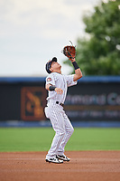 Staten Island Yankees shortstop Eduardo Torrealba (13) settles under a pop up during a game against the Lowell Spinners on August 22, 2018 at Richmond County Bank Ballpark in Staten Island, New York.  Staten Island defeated Lowell 10-4.  (Mike Janes/Four Seam Images)