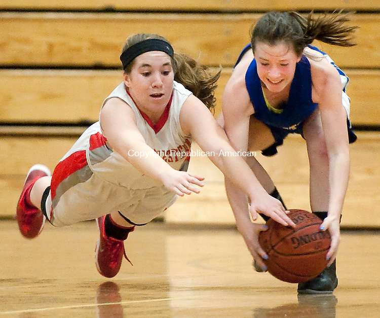 WINSTED, CT-022214JS06- Northwestern's Amanda Soltis (2) and Housatonic's Chloe Dakers (2) both dive for a loose ball during their Berkshire League tournament game Saturday at Northwest Regional High School in Winsted. <br /> Jim Shannon Republican-American