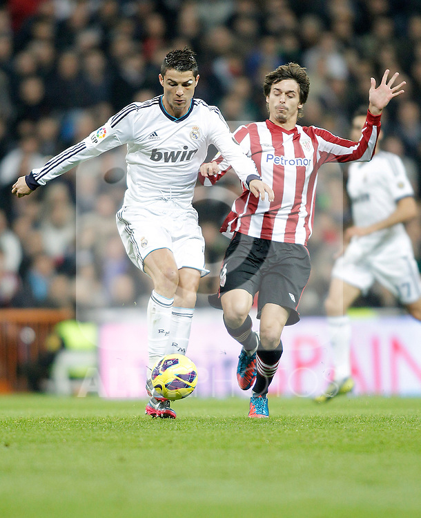 Real Madrid's Cristiano Ronaldo against Athletic de Bilbao's Ander Iturraspe during La Liga Match. November 17, 2012. (ALTERPHOTOS/Alvaro Hernandez)