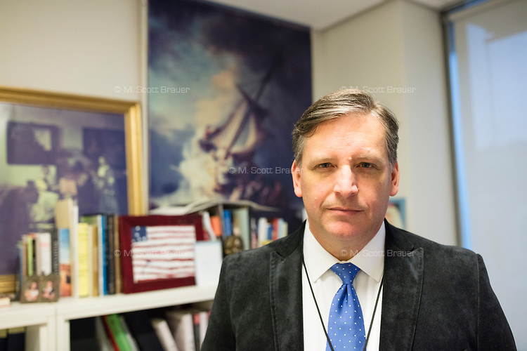 """Anthony Amore is the Directory of Security and Chief Investigator at the Isabella Stewart Gardner Museum in Boston, Mass., USA, seen here in his office on Tues., Dec. 5, 2017. Part of Amore's ongoing work is the investigation into the 1990 theft of 13 pieces from the museum: 10 paintings, 2 objects, and 1 etching. Among the paintings stolen were works by Rembrandt, Vermeer, Degas, and Manet. On the wall are reproductions of two paintings taken in the heist, Vermeer's """"The Concert"""" (left) and Rembrandt's """"The Storm on the Sea of Galilee."""""""