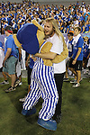 Scratch hugs a student before the class photo at Big Blue U at Commonwealth Stadium on August 18th, 2012. During K Week the freshman get introduced to the cheers and fight song by coaches and staff. Photo by Genevieve Adams | Staff