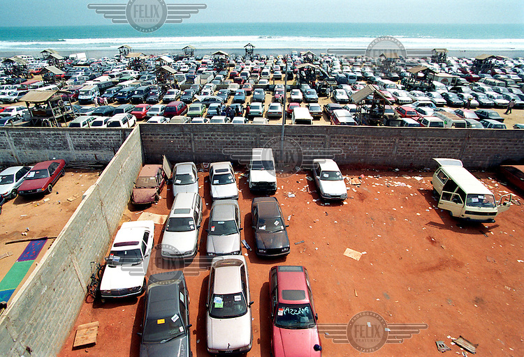 ©Sven Torfinn/Panos Pictures ..Benin, Cotonou, 2002.in the harbour, port of Cotonou, capital at the coast. .second hand car business, cars coming from Europe, economy, trade, import, enviroment..in the background the sea.