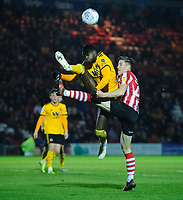 Lincoln City's Adam Crookes vies for possession with Wolverhampton Wanderers U21's Dominic Iorfa<br /> <br /> Photographer Chris Vaughan/CameraSport<br /> <br /> The EFL Checkatrade Trophy Northern Group H - Lincoln City v Wolverhampton Wanderers U21 - Tuesday 6th November 2018 - Sincil Bank - Lincoln<br />  <br /> World Copyright © 2018 CameraSport. All rights reserved. 43 Linden Ave. Countesthorpe. Leicester. England. LE8 5PG - Tel: +44 (0) 116 277 4147 - admin@camerasport.com - www.camerasport.com
