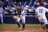 Lakeland Flying Tigers catcher Kade Scivicque (28) fields a throw as Mark Payton (11) scores a run during a game against the Tampa Yankees on April 8, 2016 at George M. Steinbrenner Field in Tampa, Florida.  Tampa defeated Lakeland 7-1.  (Mike Janes/Four Seam Images)