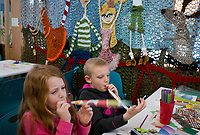 NWA Democrat-Gazette/CHARLIE KAIJO Carson Kent 6, of Fayetteville (left) and Gavin Johnson 9 of Joplin, Mo. make party blowers during the Zing in The New Year! event on Sunday, December 31, 2017 at Amazeum in Bentonville. Visitors wrote down New Year's wishes and made party hats and noise makers  and enjoyed the general activities