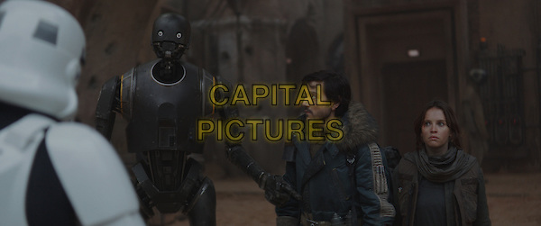 Rogue One: A Star Wars Story (2016)<br /> K-2SO (Alan Tudyk), Cassian Andor (Diego Luna) and Jyn Erso (Felicity Jones)<br /> *Filmstill - Editorial Use Only*<br /> CAP/KFS<br /> Image supplied by Capital Pictures