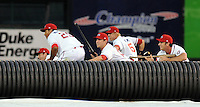 Members of the Rome Braves and Greenville Drive stage a mock battle with rifle-bats, attacking from opposite sides of the field, during a lengthy rain delay before a game on July 5, 2012, at Fluor Field at the West End in Greenville, South Carolina. (Tom Priddy/Four Seam Images)