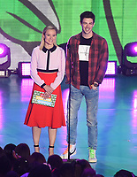 LOS ANGELES, CA - MARCH 24: Kristen Bell and Grant Gustin appear on the Nickelodeon Kids Choice Awards 2018 at The Forum on March 24, 2018 in Los Angeles, California. (Photo by Frank Micelotta/PictureGroup)