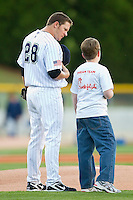 "Starting pitcher Jake Peavy #28 of the Charlotte Knights chats with a member of the ""Dream Team"" prior to the National Anthem at Knights Stadium on April 13, 2011 in Fort Mill, South Carolina.    Photo by Brian Westerholt / Four Seam Images"