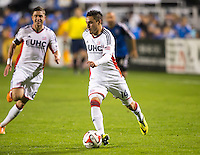 Santa Clara, California -Saturday, March 29, 2014: Diego Fagundez of New England Revolution dribbles the ball during a match against San Jose Earthquakes at Buck Shaw Stadium. Final Score: SJ Earthquakes 1, NE Revolution 2