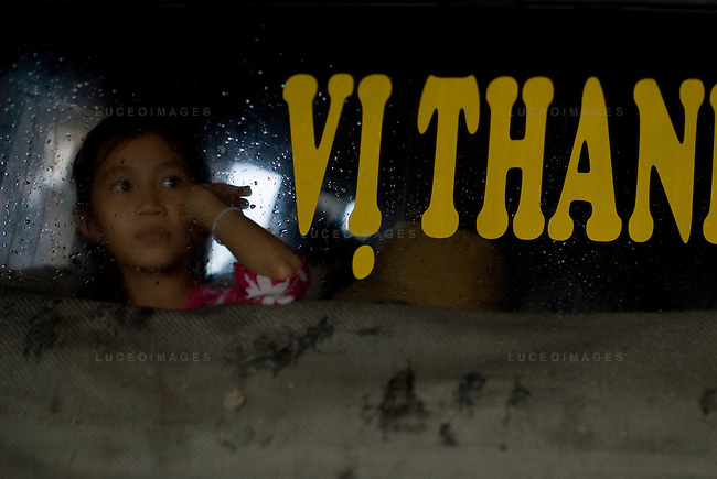 A Vietnamese girl looks out of a bus while heading back to her home in Ho Chi Minh City, Vietnam.
