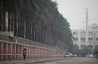A general view of the road that runs past the Yue Yuen Industrial Holdings Limited factory in Dongguan, Guangdong Province, China, 03 March 2015.