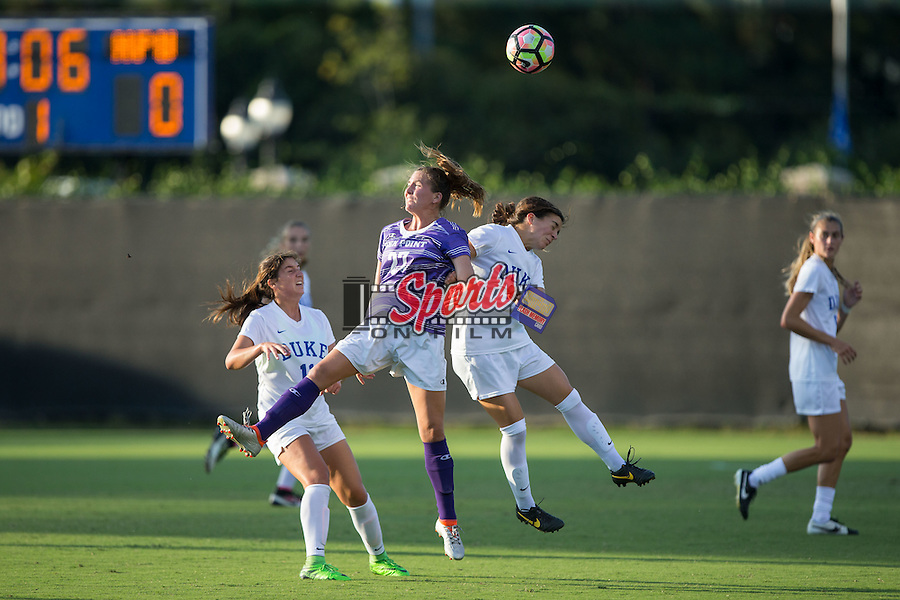 Bailey Beattie (27) of the High Point Panthers heads the ball away from Christina Gibbons (31) of the Duke Blue Devils during first half action at Koskinen Stadium on September 11, 2016 in Durham, North Carolina.  The Blue Devils defeated the Panthers 4-1.   (Brian Westerholt/Sports On Film)