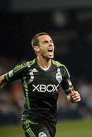 Zach Scott (20) defender Seattle Sounders celebrates his goal..Sporting Kansas City defeated Seattle Sounders on penalty kicks, after a 1-1 tied game to win the Lamar Hunt Open Cup at LIVESTRONG Sporting Park, Kansas City, Kansas..