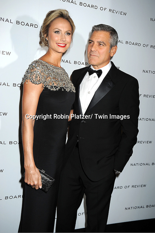 Stacy Keibler in Marchesa balck and silver dress and George Clooney attend The National Board of Review Film Awards Gala on January 10, 2012 at Cipriani 42nd Street in New York City.