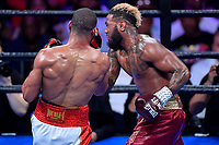 """Fairfax, VA - May 11, 2019: Julian J-Rock"""" Williams lands an uppercut against Jarrett """"Swift"""" Hurd during Jr. Middleweight title fight at Eagle Bank Arena in Fairfax, VA. Julian Williams defeated Hurd to take home the IBF, WBA and IBO Championship belts by unanimous decision. (Photo by Phil Peters/Media Images International)"""