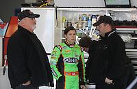 Danica Patrick talks with Tony Eury, Jr. and Tony Eury , Sr., ARCA testing at Daytona International Speedway, Daytona Beach, FL, December 2009.  (Photo by Brian Cleary/www.bcpix.com)