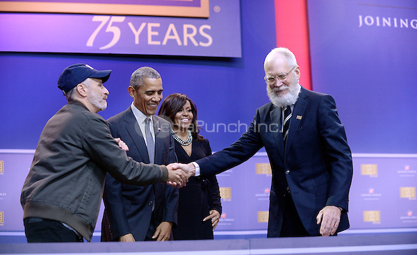 Comedian Jon Stewart checks hands with David Letterman as President Barack Obama and First Lady Michelle Obama look on at the kick off of the 5th anniversary of Joining Forces and the 75th anniversary of the USO at Joint Base Andrews on May 5, 2016 in Maryland. <br /> Credit: Olivier Douliery / Pool via CNP/MediaPunch