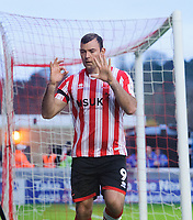 Lincoln City's Matt Rhead celebrates scoring the opening goal<br /> <br /> Photographer Chris Vaughan/CameraSport<br /> <br /> The Emirates FA Cup Second Round - Lincoln City v Carlisle United - Saturday 1st December 2018 - Sincil Bank - Lincoln<br />  <br /> World Copyright © 2018 CameraSport. All rights reserved. 43 Linden Ave. Countesthorpe. Leicester. England. LE8 5PG - Tel: +44 (0) 116 277 4147 - admin@camerasport.com - www.camerasport.com