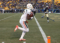 Miami wide receiver Stacy Coley scores on a 32-yard touchdown reception. The Miami Hurricanes defeated the Pitt Panthers 41-31 at Heinz Field, Pittsburgh, Pennsylvania on November 29, 2013.
