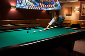 """May 19, 2012.""""Following the conclusion of the G8 Summit, the President plays a game of pool in the Holly Cabin at Camp David."""" .Mandatory Credit: Pete Souza - White House via CNP"""