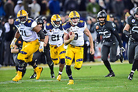 Baltimore, MD - DEC 10, 2016: Navy Midshipmen quarterback Zach Abey (9) breaks free for a long touchdown run during game between Army and Navy at M&T Bank Stadium, Baltimore, MD. (Photo by Phil Peters/Media Images International)