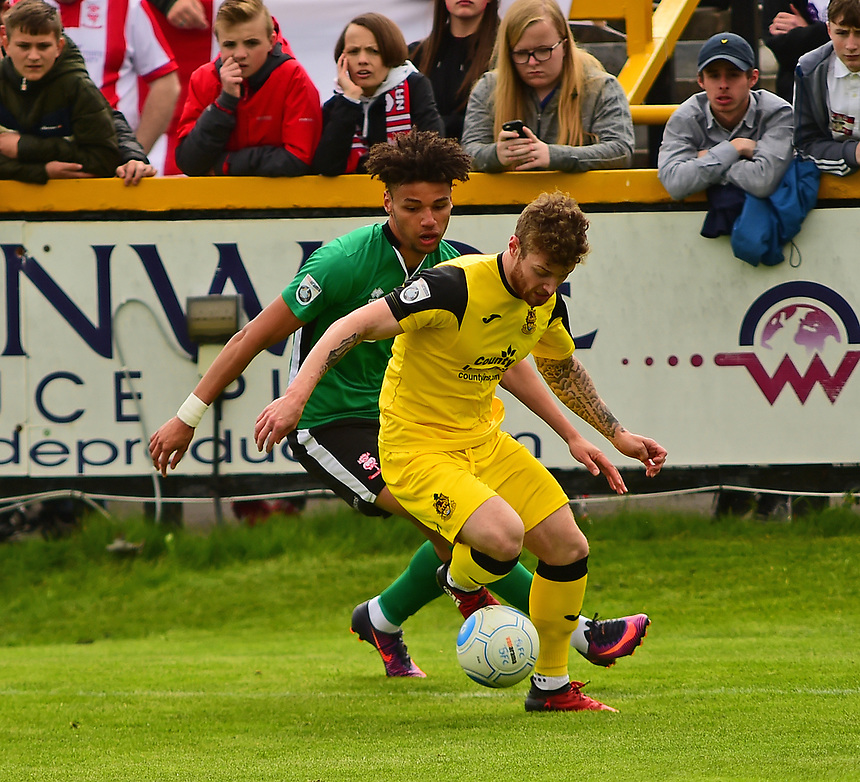 Lincoln City's Lee Angol vies for possession with Southport's Ryan Higgins<br /> <br /> Photographer Andrew Vaughan/CameraSport<br /> <br /> Vanarama National League - Southport v Lincoln City - Saturday 29th April 2017 - Merseyrail Community Stadium - Southport<br /> <br /> World Copyright &copy; 2017 CameraSport. All rights reserved. 43 Linden Ave. Countesthorpe. Leicester. England. LE8 5PG - Tel: +44 (0) 116 277 4147 - admin@camerasport.com - www.camerasport.com