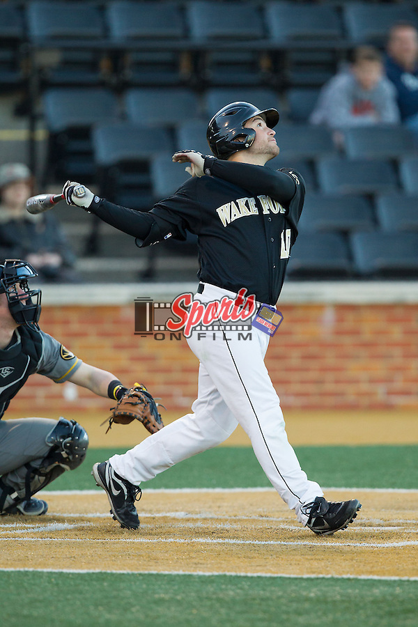 Nate Mondou (10) of the Wake Forest Demon Deacons follows through on his swing against the Missouri Tigers at Wake Forest Baseball Park on February 22, 2014 in Winston-Salem, North Carolina.  The Demon Deacons defeated the Tigers 1-0.  (Brian Westerholt/Sports On Film)