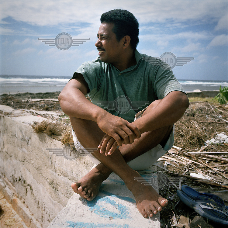 Tangaroa is a teacher, he sits on a sea wall that was built in front of his school after a storm caused floods. Due to rising sea levels severe weather can have a more damaging effect upon the islands.
