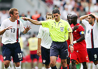 Jimmy Conrad (13) of the USA reacts after referee Markus Merk awards a penalty kick to Ghana. Ghana defeated the USA 2-1 in their FIFA World Cup Group E match at Franken-Stadion, Nuremberg, Germany, June 22, 2006.