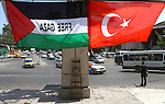 Palestinians comment the Palestinian national flag and the turkish flag in the streets in Gaza City on July 21, 2011 following Erdogan's statement that he was considering visiting the Hamas-run Gaza Strip, a move likely to anger Israel amid diplomatic efforts to overcome already strained bilateral ties. Photo by Ashraf Amra