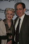 Angela Lansbury & moderator Anthony Tommasini celebrate on January 10, 2010 at the New York Times Arts & Leisure Weekend at the TimesCenter Stage, New York City, New York. (Photo by Sue Coflin/Max Photos)