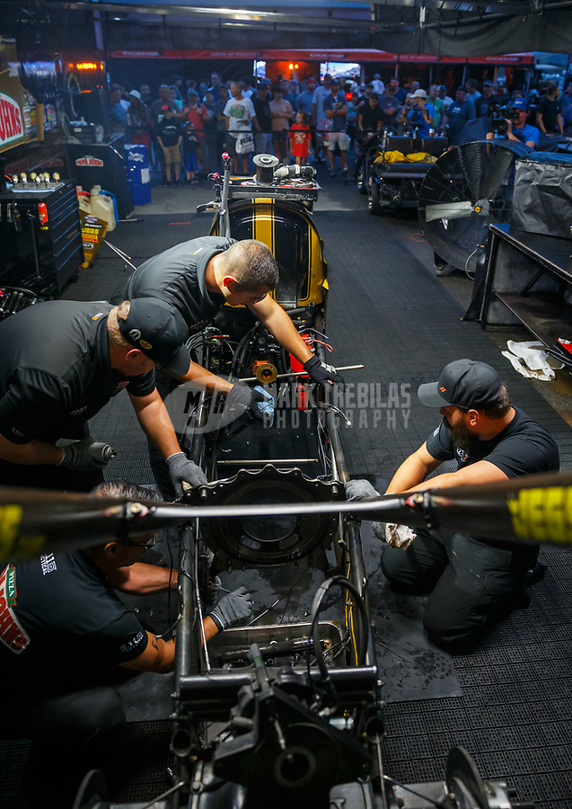 Jul 21, 2017; Morrison, CO, USA; Crew members for NHRA top fuel driver Leah Pritchett during qualifying for the Mile High Nationals at Bandimere Speedway. Mandatory Credit: Mark J. Rebilas-USA TODAY Sports