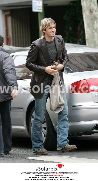 ALL-ROUND EXCLUSIVE PICTURES FROM SOLARPIX.COM.****NO PUBLICATION IN SPAIN****.David Beckham was all smiles today as he arrived for a photo-shoot for a Spanish sports newspaper. He has stayed behind in Madrid to practice for the Real Madrid v Arsenal match on Tuesday, while Victoria and the children take a half term skiing holiday in the Spanish Pyrenees with her parents..REF: 2141 ERP
