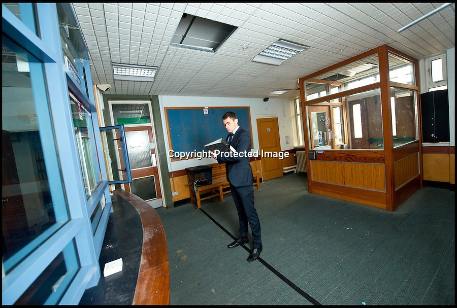BNPS.co.uk (01202 558833)<br /> Pic: RachelAdams/BNPS<br /> <br /> Valuer Ed Impey measures up the reception area.<br /> <br /> Potential buyers of this property that is for sale will hope to get it for a real steal.<br /> <br /> The three-storey building is actually a derelict police station that used to house scores of police officers and dozens of prisoners.<br /> <br /> The building used to serve as the main police station for Poole, Dorset, until 2009 when the force moved to a state-of-the-art HQ nearby.<br /> <br /> The 1930s building, that sits a 0.89 of an acre site, has lain mostly empty since then, at a cost of hundreds of thousands of pounds a year to the taxpayer.<br /> <br /> It is now gone on the market with interested parties invited to make sealed bids.